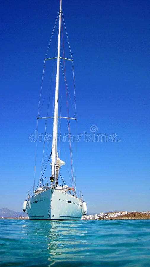 Sailing boat in blue sea royalty free stock photos