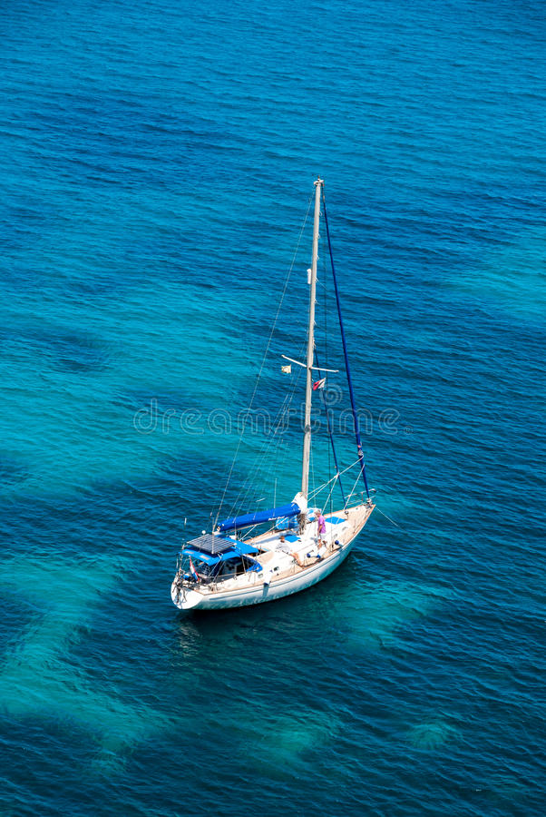 Download Sailing Boat In Blue Water Bay Stock Photo - Image: 41797230