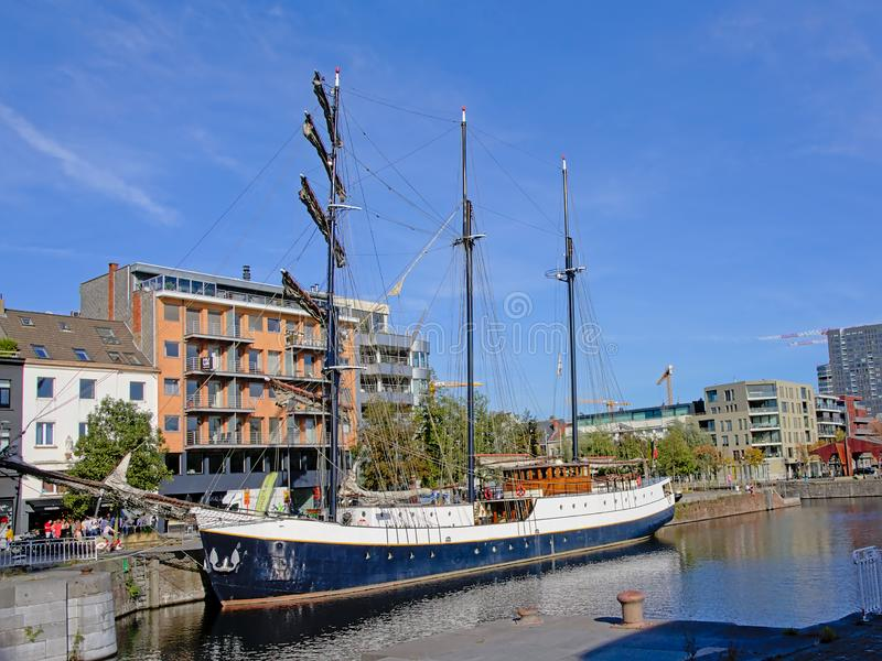 Sailing boat in a dock in the city of Antwerp royalty free stock photo