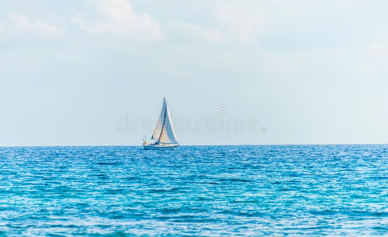 sailing boat flowing on the sea, a cruise on the open sea, sailing royalty free stock image