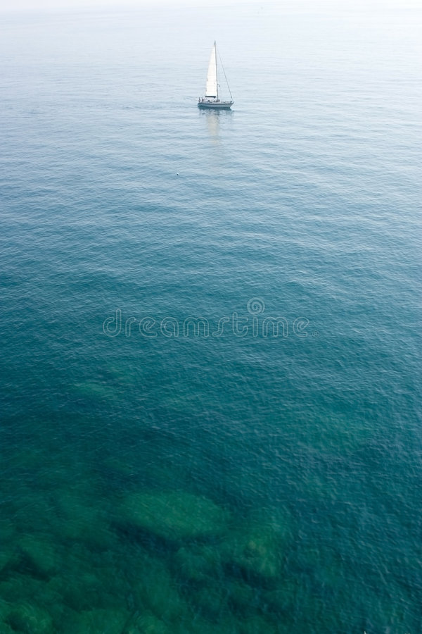 Free Sailing Boat In Limpid Water Royalty Free Stock Photos - 2373328