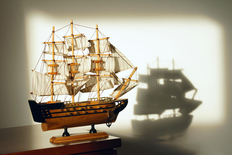 Sailing boat model. The close-up of a sailing boat model in sunshine royalty free stock photography
