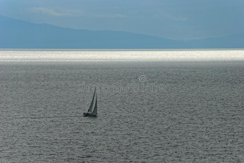 Sailing boat in the morning royalty free stock image