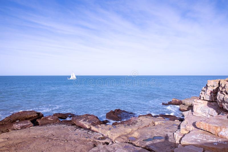 Landscape Coast and sailing boat in Mar del Plata Argentina stock photography