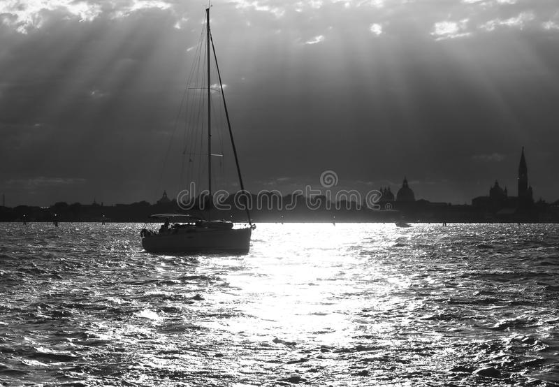 Sailing boat in the sea with backlit photographic effect. Sailing boat in the sea with backlit and Black and White photographic effect stock photography