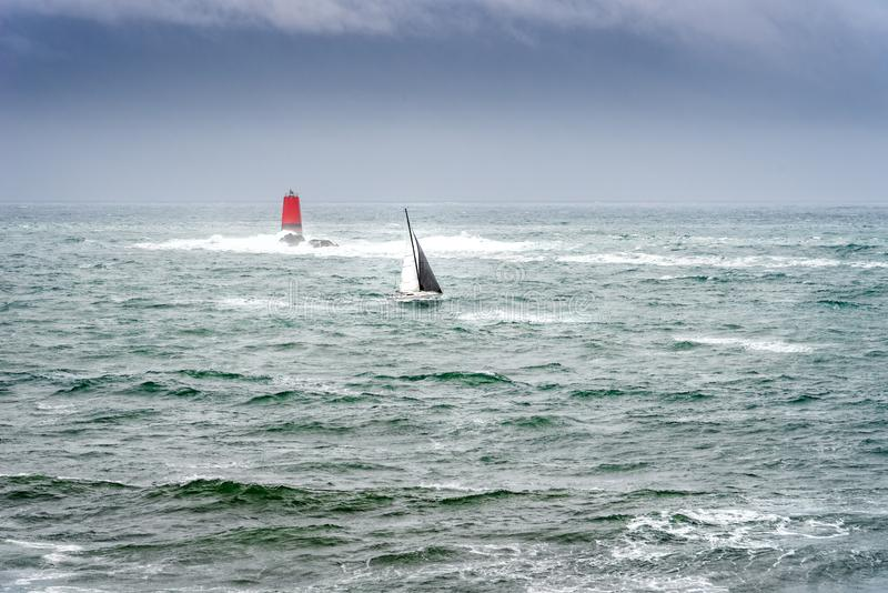 Sailing boat in the sea with stormy weather royalty free stock photo