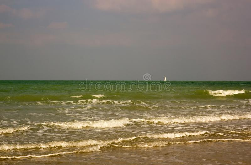 Sailing boat, small point on the vastness. Dieppe, Seine-Maritime, France. Sailing boat, small point on the vastness royalty free stock image