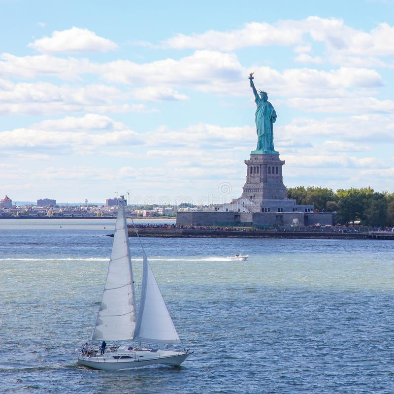 Sailing boat at the Statue of Liberty in New York City royalty free stock photos
