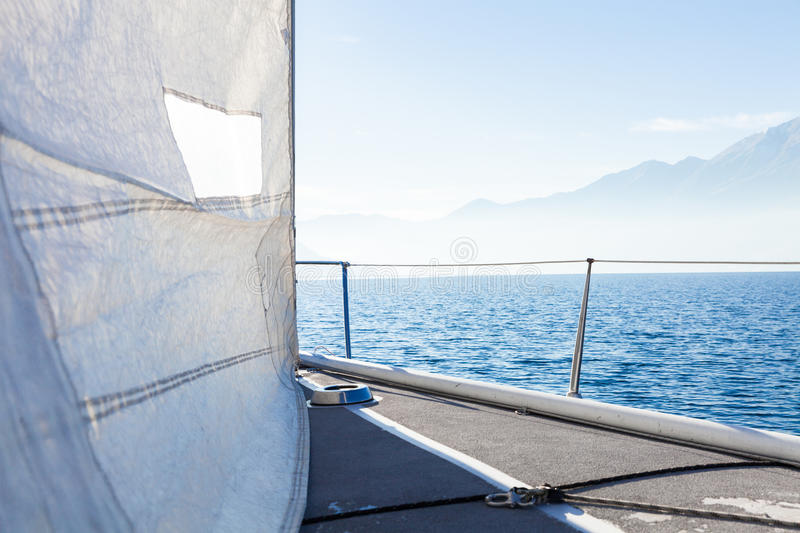 Sailing boat in sunny day in the lake, empty space stock photo