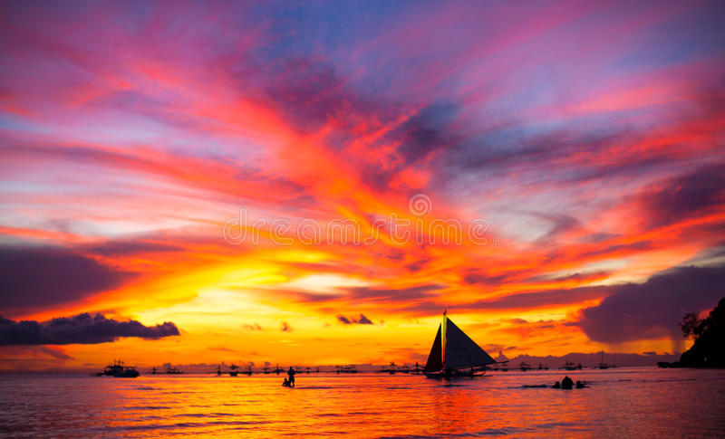 Sailing boat to the sunset royalty free stock images