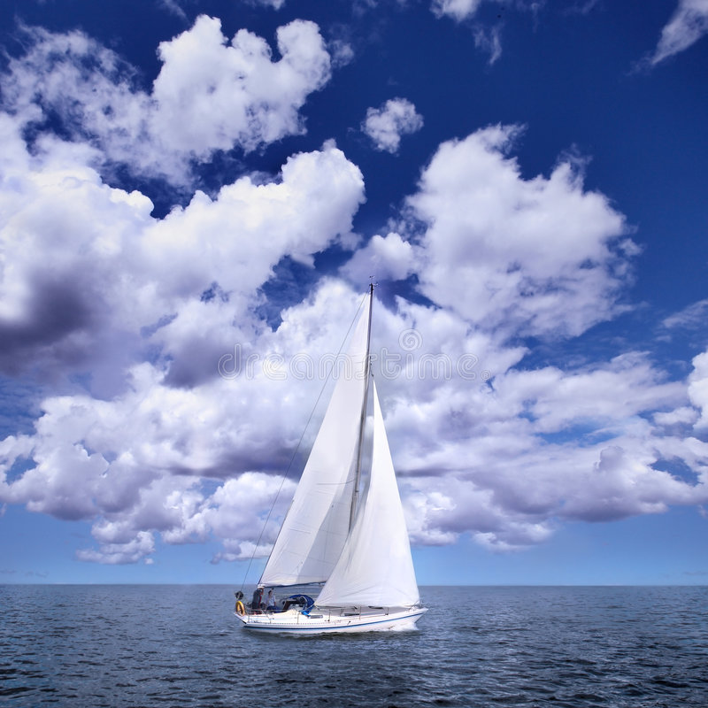 Sailing boat in the wind. Photo of Sailing boat in the wind a summerday stock photo