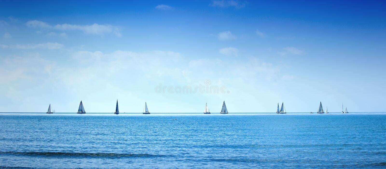 Sailing boat yacht regatta race on sea or ocean water stock photo