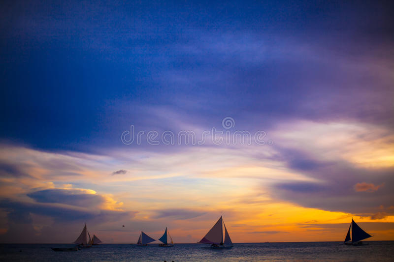 Sailing boats in beautiful sunset royalty free stock images