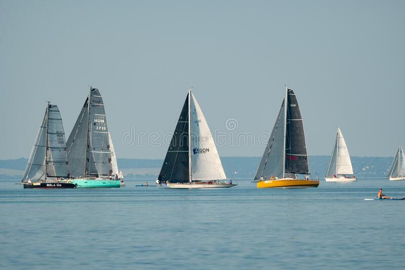 Sailing boats compete on 52.nd Kékszalag stock photo