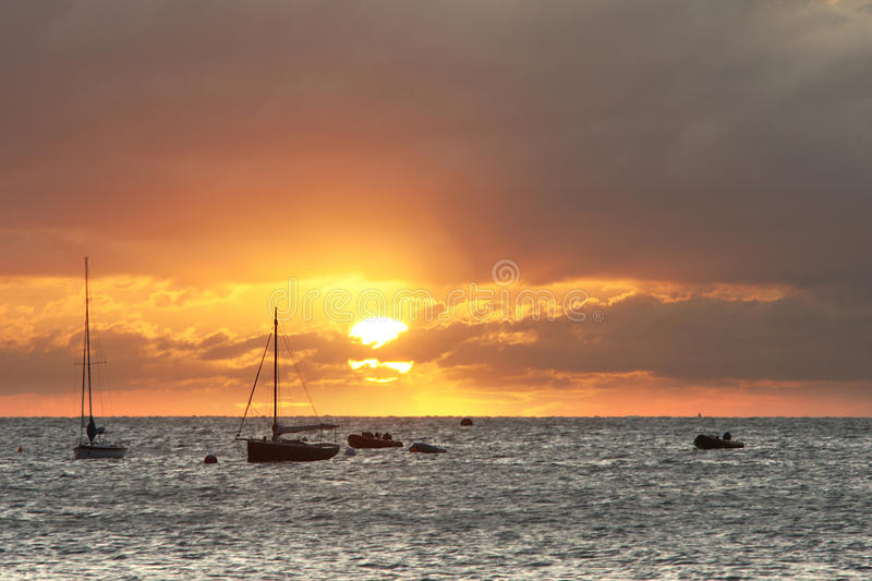 Download Sailing Boats On Horizon Bathed In Sun's Rays Stock Image - Image: 10817469