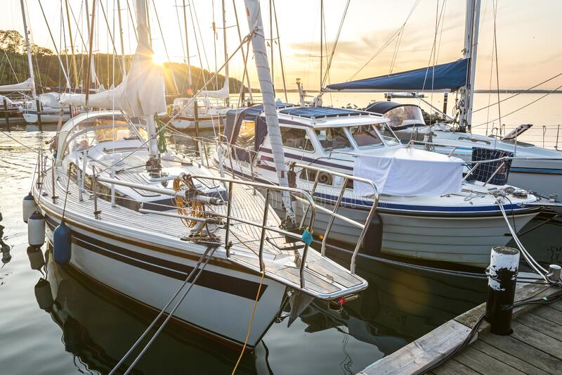 Sailing boats in a marina during a beautiful golden sunset at the Baltic Sea. In Northern Germany Langballigau royalty free stock photography