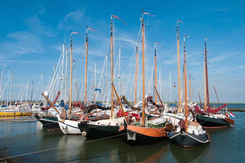 Sailing boats moored in a little harbour stock photos