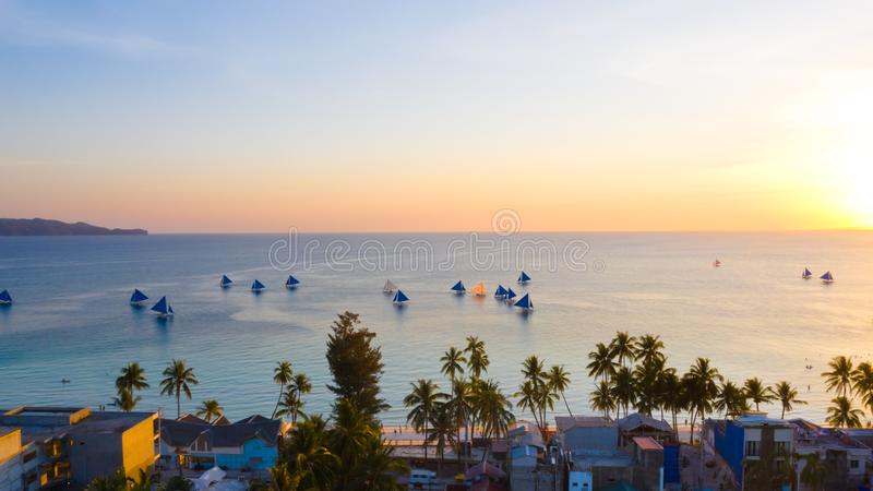 Sailing boats off Boracay island at sunset stock photo