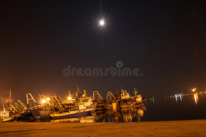 Sailing boats at port in night stock photo