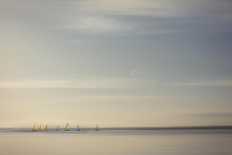 Sailing boats racing with colourful sails, backgro royalty free stock images
