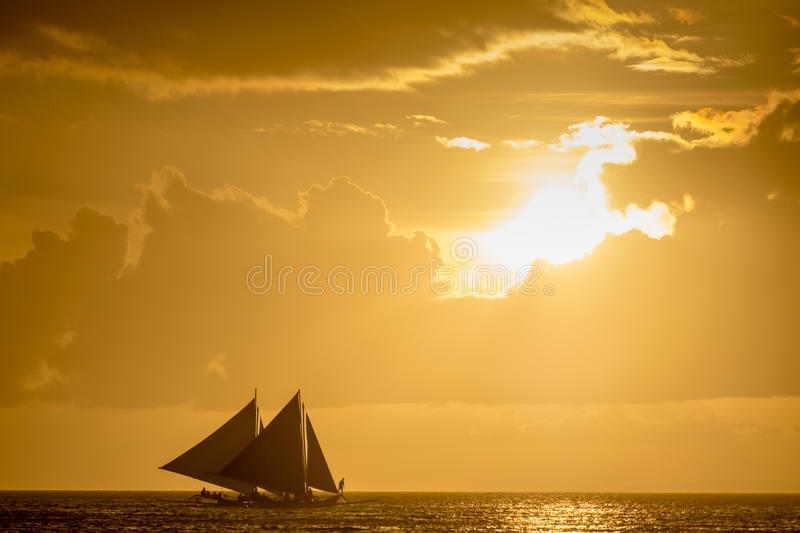 Sailing boats on the sea at the sunset at Boracay island stock photos
