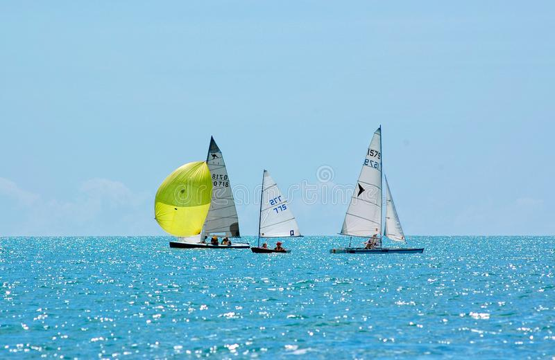 Sailing in calm water stock photo