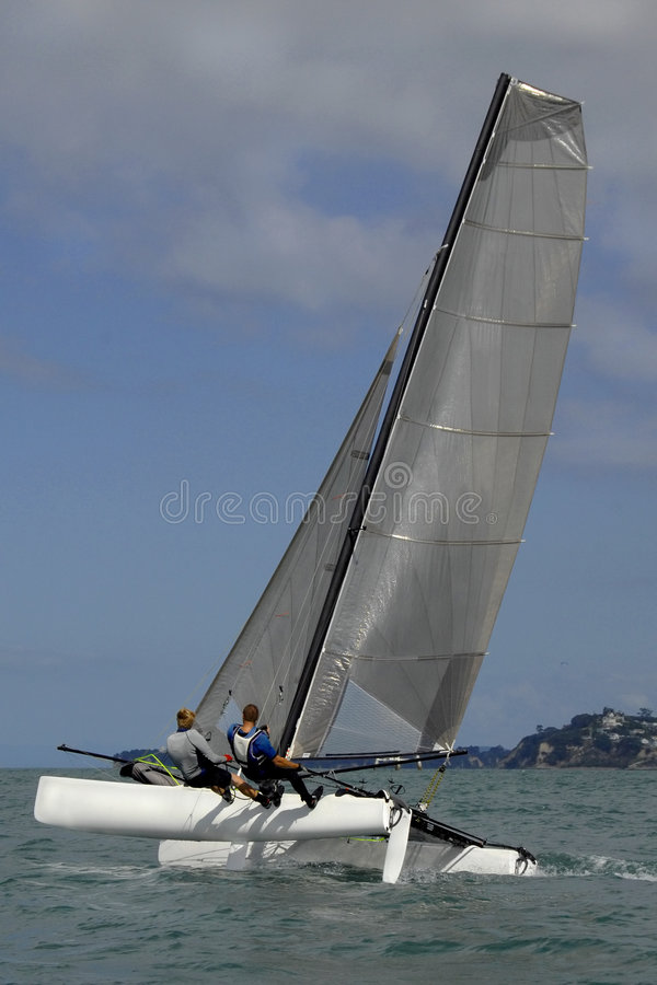 Sailing on a Catamaran Yacht stock images