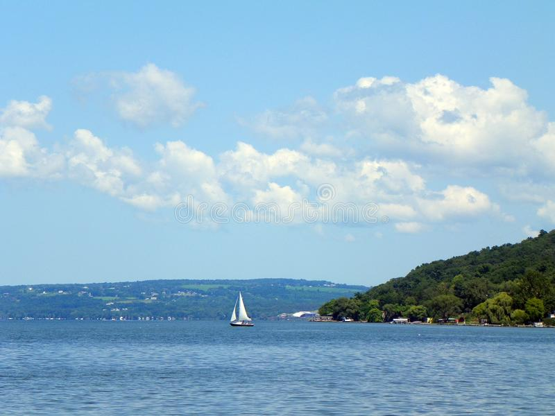 Sailing on Cayuga Lake near Ithaca in the FingerLakes. Cayuga Lake is the longest of central New York`s glacial Finger Lakes, and is the second largest in stock photography