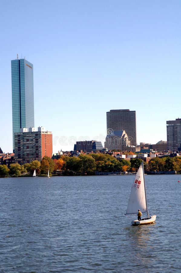 Sailing Charles River Boston. A view of a sailboat on the Charles River in Boston on a fall day royalty free stock photography