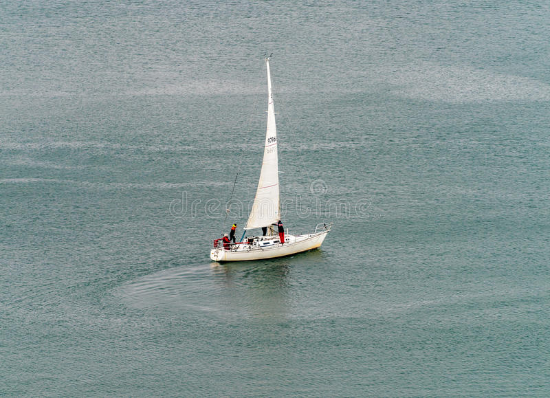 Sailing in a cold day royalty free stock photography