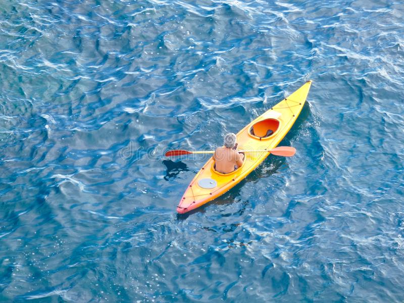 Man sailing in Kayak through the waters of the sea royalty free stock photos