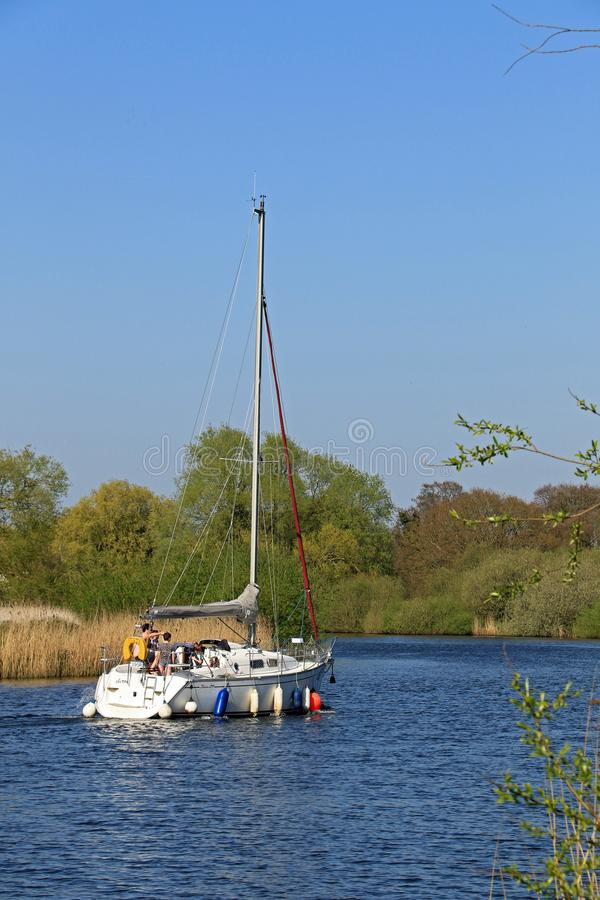 Sailing down the River Yare. Surlingham is a village and civil parish in South Norfolk situated on the Broads United Kingdom. It lies approximately 6½ miles stock image