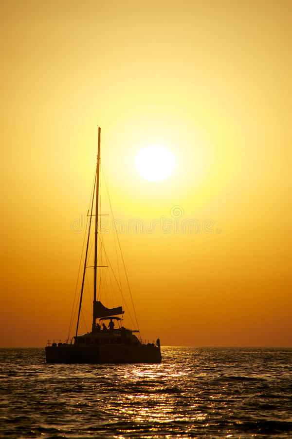 Sailing in the evening stock images