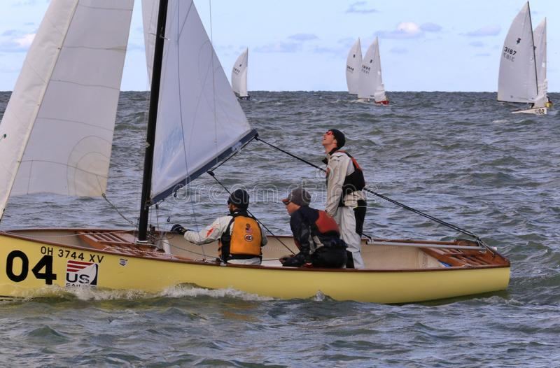 Sailing Federation event. Crew works on the rigging and rudder at the United States Sailing Associations Championship of Champions Title at Edgewater Yacht Club stock photos