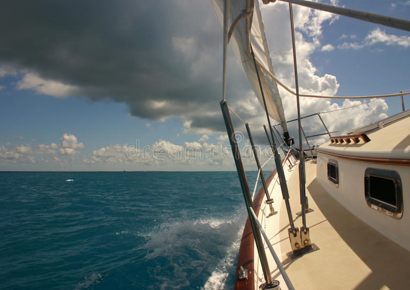 Sailing in the Florida Keys. A nice yacht sailing in the Florida Keys on a sunny but stormy day royalty free stock photo