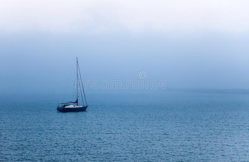 Sailing in fog royalty free stock photos
