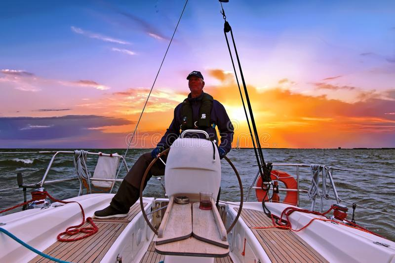 Sailing on the IJsselmeer in Netherlands at sunset royalty free stock photo