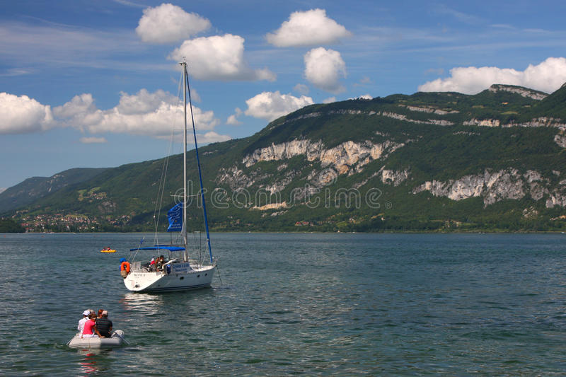 Sailing on Lac du Bourget. Lac du Bourget is a lake in the department of Savoie, France. It is the largest and the deepest lake located entirely within France stock photography