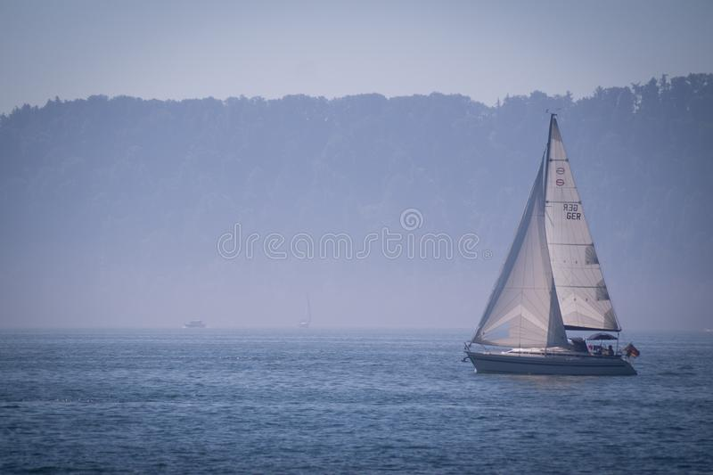 Sailing on a lake stock images