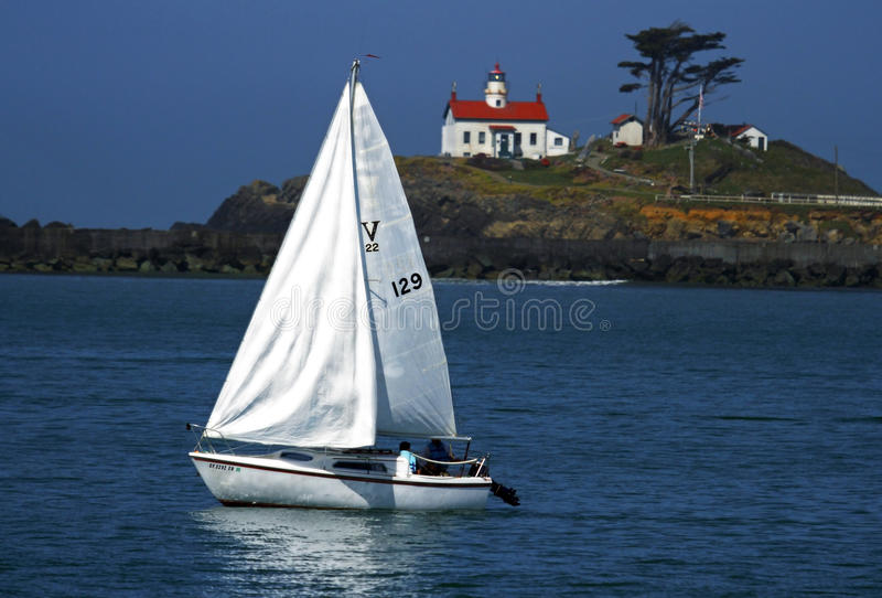 Sailing by the Lighthouse stock images