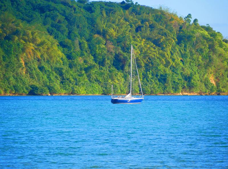 Sailing n the Caribbean sea ocean on yacht boat with mountains in sight - Jamaica royalty free stock photos