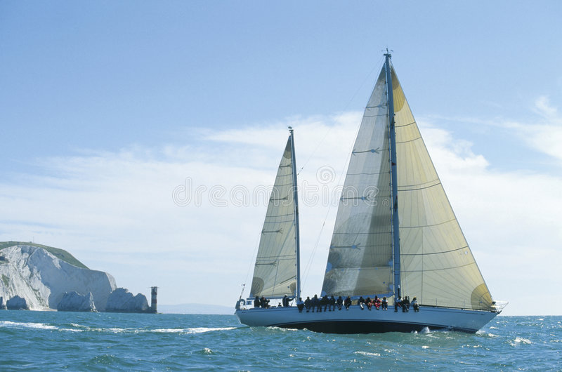 Sailing by the Needles stock images
