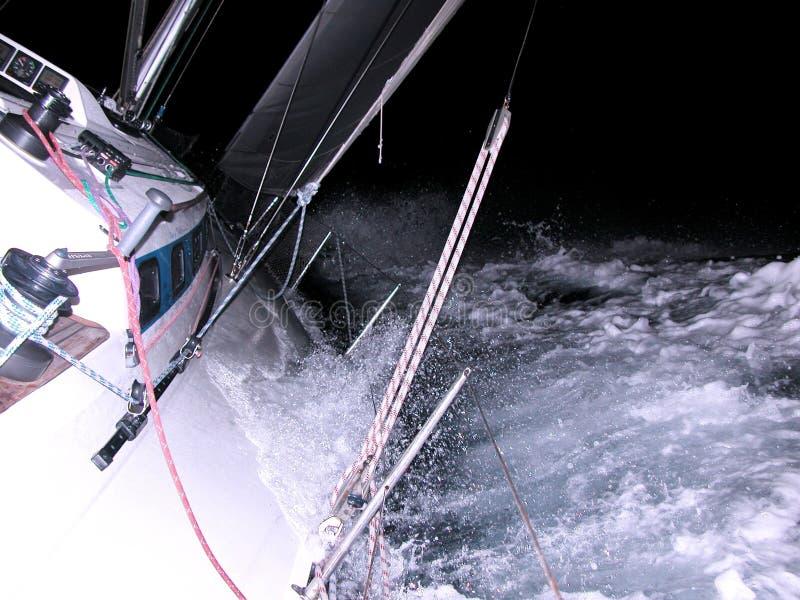 Sailing at night royalty free stock image
