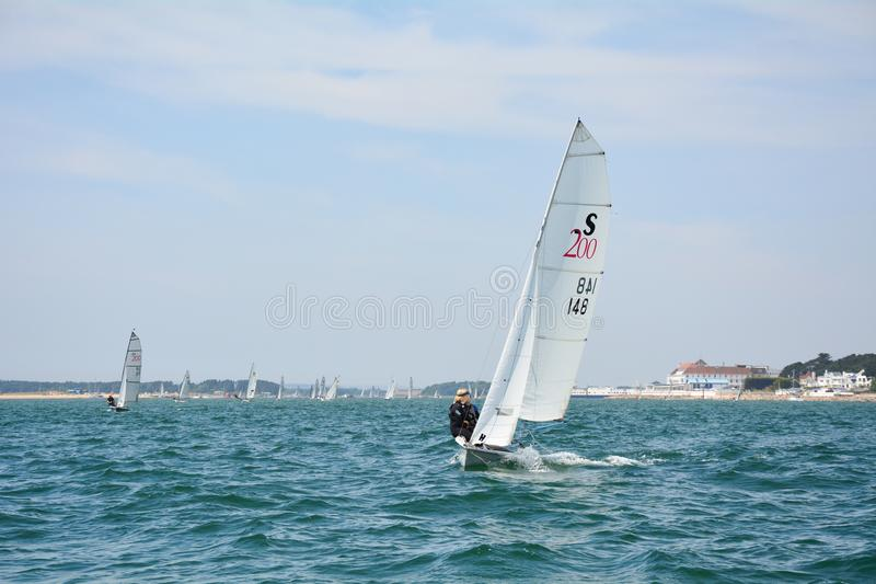 Sailing through Poole Harbour Entrance. Bournemouth Bay Dorset United Kingdom. 23 June 2018. RS200 sailing into Bournemouth Bay royalty free stock photos