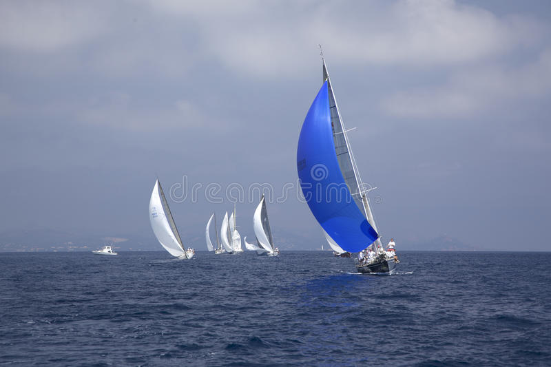 Sailing race. Photography of group of yacht with spinnakers, 2nd day of Giraglia Rolex Cup 2009 royalty free stock image