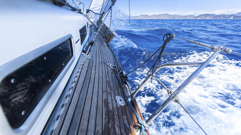 Sailing. Racing yacht in the Mediterranean sea on blue sky background. Luxury Lifestyle stock photography