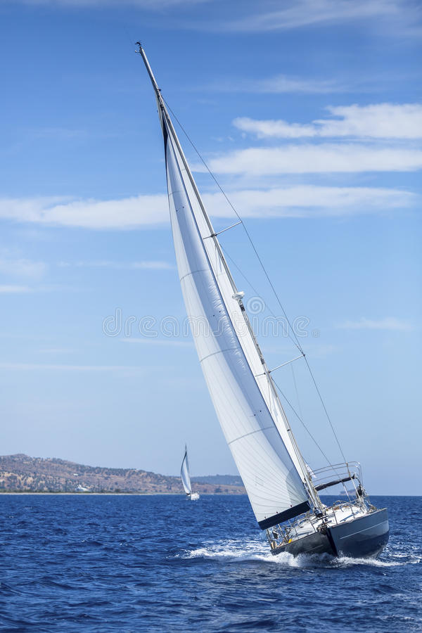 Sailing, racing yachts on the high seas. royalty free stock images