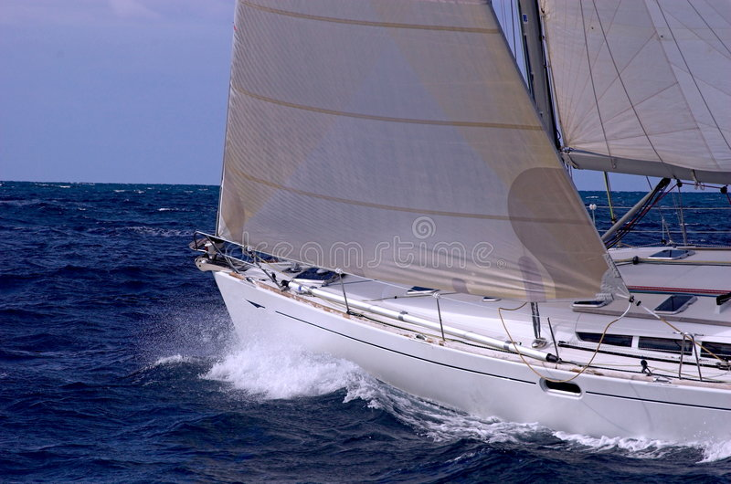 Sailing in regatta royalty free stock image