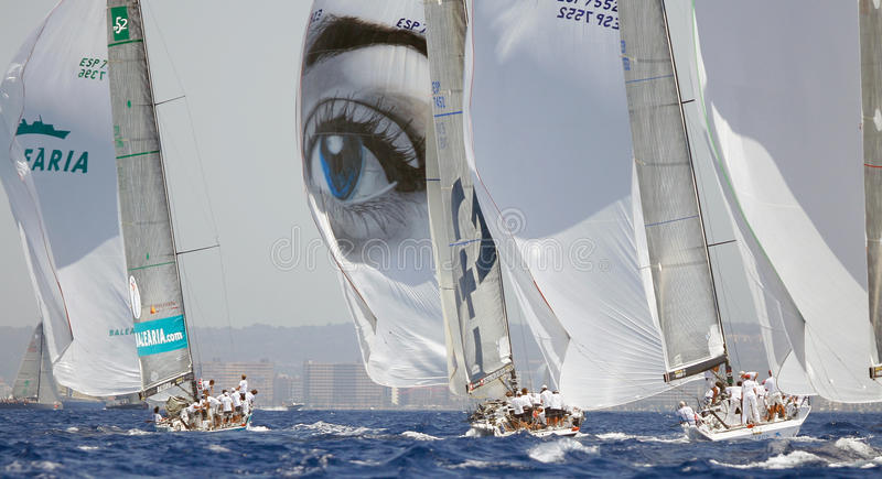 Sailing regatta spinnakers on. Sail ships compete during the copa del rey Sailing Race regatta in Palma on the Spanish Balearic island of Mallorca royalty free stock photos