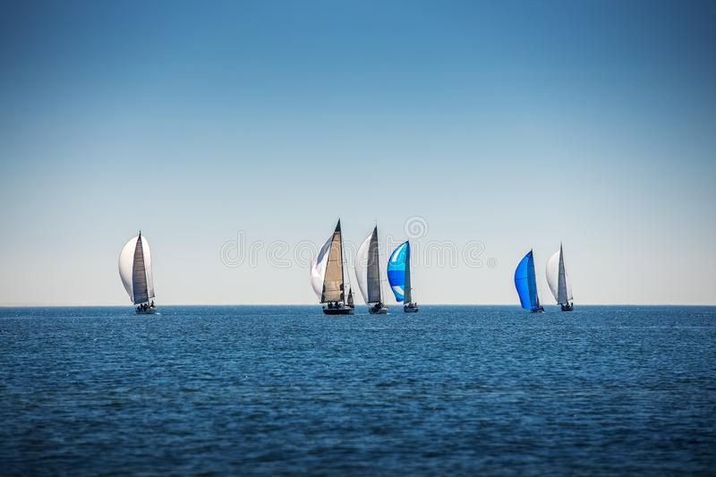 Sailing Regatta in the wind through the waves at the sea royalty free stock photography